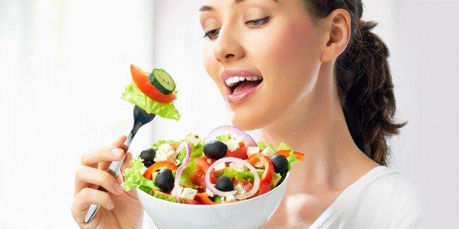 Woman eating Mediterranean salad